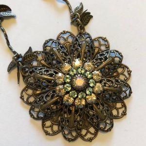 Antique gold finish with floral motif pendant